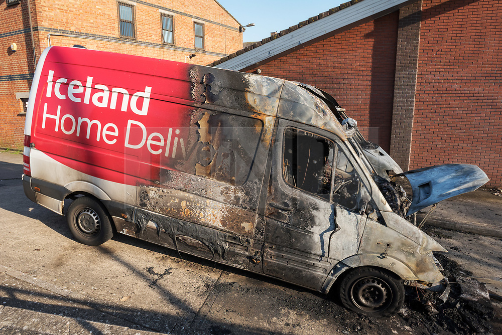 © Licensed to London News Pictures; 24/03/2020; Bristol, UK. Coronavirus Pandemic; Two Iceland supermarket delivery vans are seen burnt out behind the Iceland store on Ullswater Road. The vans, needed for food deliveries during the coronavirus crisis, were set on fire last night after disturbances broke out in the Southmead area of Bristol at around 9.30pm after the Prime Minister spoke to the nation on TV and announced a lockdown to prevent the spread of coronavirus, with the biggest restrictions on freedom of movement ever imposed in the UK. People are told to stay at home except for essential work that cannot be done at home, shopping for food, medical appointments and taking exercise once a day all while maintaining social distance. Photo credit: Simon Chapman/LNP.