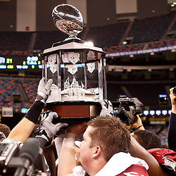 December 18, 2010; New Orleans, LA, USA; Troy Trojans players hold up the New Orleans Bowl Trophy following a win over the Ohio Bobcats in the 2010 New Orleans Bowl at the Louisiana Superdome. Troy defeated Ohio 48-21. Mandatory Credit: Derick E. Hingle