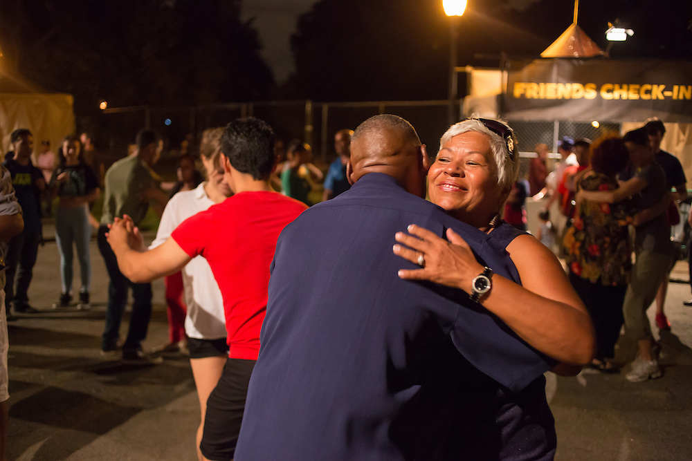 Couples dancing to the music of Eddie Palmieri.