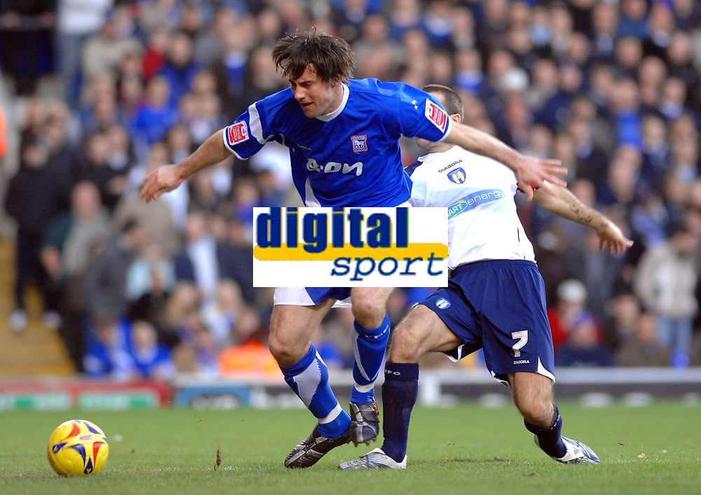Photo: Ashley Pickering.<br />Ipswich Town v Colchester United. Coca Cola Championship. 20/01/2007.<br />Ipswich's Alan Lee (L) and Colchester's Karl Duguid