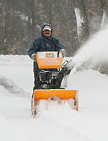 Ron Egan of Gilford gets a jump on snowblowing his driveway Thursday morning as heavy snow continued to fall through the day for the most substantial snow storm of 2012.  (Karen Bobotas/for the Laconia Daily Sun)