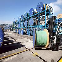 Nederland, Amsterdam , 4 september 2013.<br /> Draka is sinds 1910 een onderneming actief in de kabelindustrie. Begin 2011 is het bedrijf overgenomen door de Italiaanse beursgenoteerde kabelproducent Prysmian.<br /> Na de overname belooft Prysmian dat er tot 2014 geen gedwongen ontslagen zullen vallen. Ook daarna zou er weinig overlappende bedrijfsactiviteiten van beiden bedrijven in Nederland zijn. Zij zijn in Nederland dus complimentair voor elkaar. De enige bedrijfsactiviteit van Prysmian in Nederland is een fabriek in Delft.<br /> <br /> Op de foto de Draka productie afdeling in Amsterdam Noord.<br /> Foto:Jean-Pierre Jans