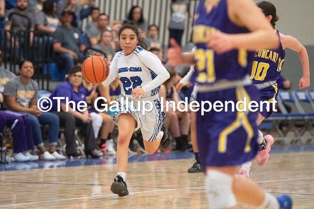 Laguna-Acoma Hawk Alenna Scott (22) drives the ball down the court Friday night against the Tucumcari Rattlers at Laguna-Acoma Jr Sr High School in Casa Blanca.
