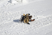 young girl crashes on her sledge in the snow