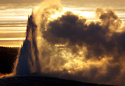 Old Faithful in Yellowstone National Park blocks out the setting of the sun, May 18 2006. Although patrons who have been coming to the nation's first national park for decades say the geyser is losing it's punch, park officials won't confirm it as fact.