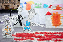 © Licensed to London News Pictures. 23/08/2018. London, UK. A 3D installation made using drawings from Rohingya children depicting the horrific attacks which forced them to flee Myanmar to Bangladesh is seen in Westminster. The stunt, organised by Save the Children, is calling for Jeremy Hunt to refer the perpetrators of these attacks to the International Criminal Court. Photo credit : Tom Nicholson/LNP