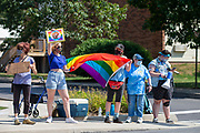 Demonstrators hold signs and a pride flag during a Pride Rally in Milton, Pennsylvania on August 8, 2020. The I Am Alliance organized the event to show support for the LGBTQ community. (Photo by Paul Weaver)
