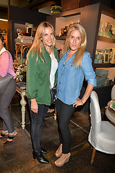 Left to right, ANDREA WACHTMEISTER and OLIVIA INNOCENTI at a party to celebrate the publication of 'Feeding The Future' by Lohralee Astor and Tali Shine held at OKA, 155-167 Fulham Road, London on 8th June 2016.