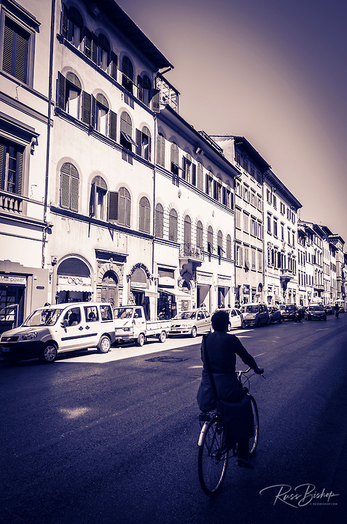 Bicycle on a busy street, Florence, Tuscany, Italy