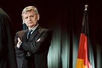 09 MAY 2001, BERLIN/GERMANY:<br /> Joschka Fischer, B90/Gruene, Bundesaussenminister, und deutsche Flagge, waehrend der Feierlichkeiten zur Einweihung der neuen israelischen Botschaft <br /> IMAGE:  20010509-02/02-25