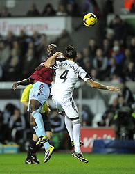 West Ham United's Carlton Cole battles for the high ball with Swansea City's Chico - Photo mandatory by-line: Joe Meredith/JMP - Tel: Mobile: 07966 386802 27/10/2013 - SPORT - FOOTBALL - Liberty Stadium - Swansea - Swansea City v West Ham United - Barclays Premier League