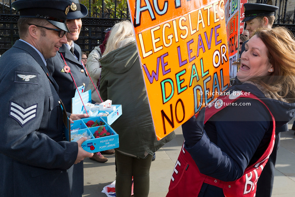 On the day that the UK was scheduled to leave the European Union and political parties commence campaigning for the General Election on 12th December, RAF military personnel sell poppies to Brexiters who are voicing their anger outside the British parliament in Westminster, on 31st October 2019,