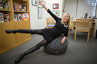 NEW YORK, NY – NOVEMBER 1, 2013:  Lisa Sharkey, the director of creative development for HarperCollins Publishers Worldwide has the $299 textured gray terrycloth cover for her office exercise ball chair and says that it's attractive looking enough to be a stand-alone piece of furniture. <br /> <br /> Photo by Robert Caplin