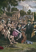 William Penn (1644-1718) English Quaker colonist, treating with native North Americans on the site of Philadelphia, November, 1682. Indian sitting on left is holding a pipe of peace. Artist, Benjamin West (1738-1820). British Museum.