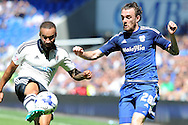 Cardiff city's Scott Malone (r) challenges Fulham's Jazz Richards. Skybet football league championship match, Cardiff city v Fulham at the Cardiff city stadium in Cardiff, South Wales on Saturday 8th August  2015.<br /> pic by Carl Robertson, Andrew Orchard sports photography.