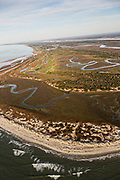 Aerial view of the undeveloped north end of Kiawah Island resort community on the Atlantic Ocean at Stono Inlet in Kiawah Island, South Carolina.