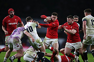 Josh Adams of Wales runs in to George Ford of England. England v Wales, NatWest 6 nations 2018 championship match at Twickenham Stadium in Middlesex, England on Saturday 10th February 2018.<br /> pic by Andrew Orchard, Andrew Orchard sports photography