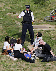 © Licensed to London News Pictures. 16/05/2020. London, UK. Police talk to people resting by the canal in Hackney Wick in east London. The government has announced a series of measures to slowly ease lockdown, which was introduced to fight the spread of the COVID-19 strain of the coronavirus Photo credit: Marcin Nowak/LNP