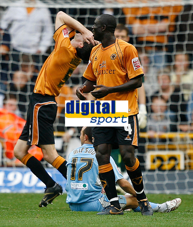Photo: Steve Bond.<br />Wolverhampton Wanderers v Coventry City. Coca Cola Championship. 06/10/2007. Gary Breen (L) canbnot believe he has had a foul given against him. Seyi Olofinjana (No4) agrees. Michael Mifsud )ground) appeals to the ref