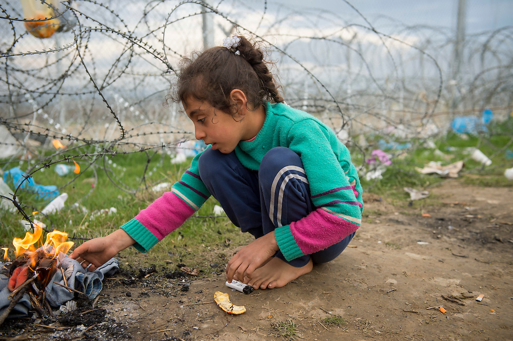 March 3, 2016, Idomeni, Greece. A young Syrian refugee camps right at the border wirh Macedonia at the Idomeni border crossing. 12.000 refugees are stuck at the Idomeni border crossing in Greece  after Macedonia closed the border.  New arrivals come in every day, making living conditions difficult.(Steven Wassenaar/Polaris)