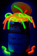 Glowing worms overflow from an open can of Cambell's Can Of Worms soup.Black light