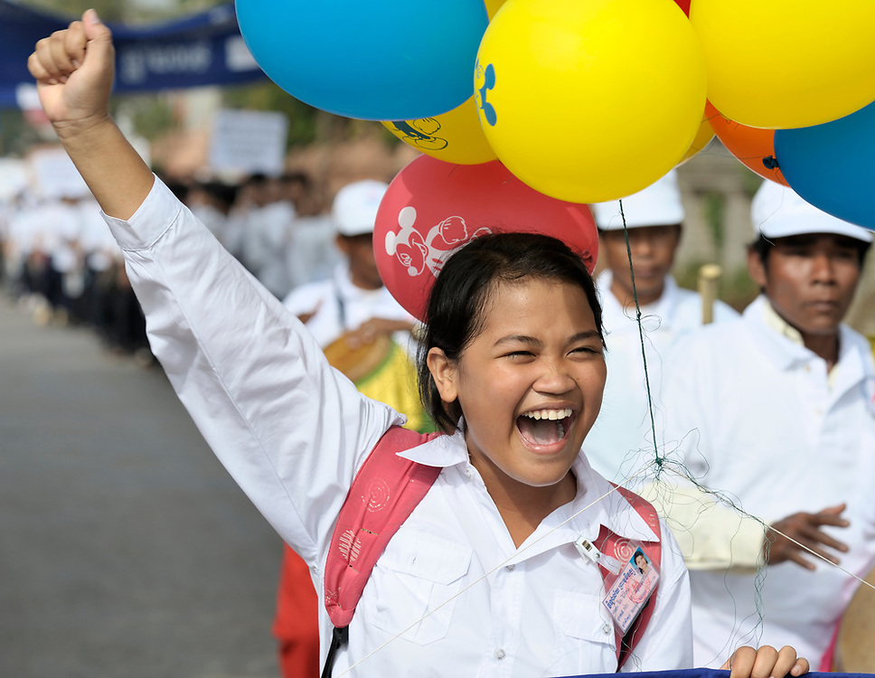 Nith Nitikar, an 18-year old student, shouts as she walks with musicians and Buddhist monks and nuns to lead a march commemorating World AIDS Day in Battambang, Cambodia. Among sponsors of the march was the Salvation Centre Cambodia, an organization that works with Buddhist monks and other activists to foster support for people living with HIV and AIDS as well as public education and advocacy throughout the country.