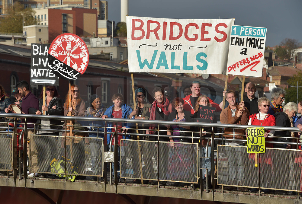 © Licensed to London News Pictures.  29/10/2017; Bristol, UK. Bristol Solidarity march 'hands across the city' at Pero's Bridge in Bristol Harbourside. Pero's bridge is named after an African slave who lived in Bristol. People from all walks of life marched in a celebration of the diversity and multiculturalism that makes Bristol great. The 'Hands Across the City' solidarity march went from Bristol Bridge to City Hall, pausing along the way to hold hands forming a 'human bridge' across Pero's Bridge to symbolise solidarity with refugees, asylum seekers and multi-cultural communities, and marks the culmination of a month-long Journey to Justice showcase. Picture credit : Simon Chapman/LNP