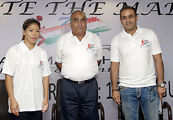NEW DELHI,INDIA – AUGUST 12: CRPF DG Dilip Trivedi with Cricketer Virender Sehwag and boxer Mary Kom at a press conference to announce 'CRPF Half Marathon- Run for Unity' in New Delhi.(Photo by Qamar Sibtain/India Today Group) *** Local Caption *** Dilip Trivedi;Virender Sehwag;Mary Kom (Credit Image: © India Today/ZUMA Wire)