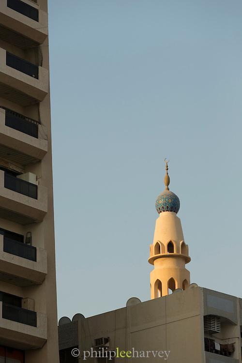 Minaret and apartment block, Dubai, United Arab Emirates