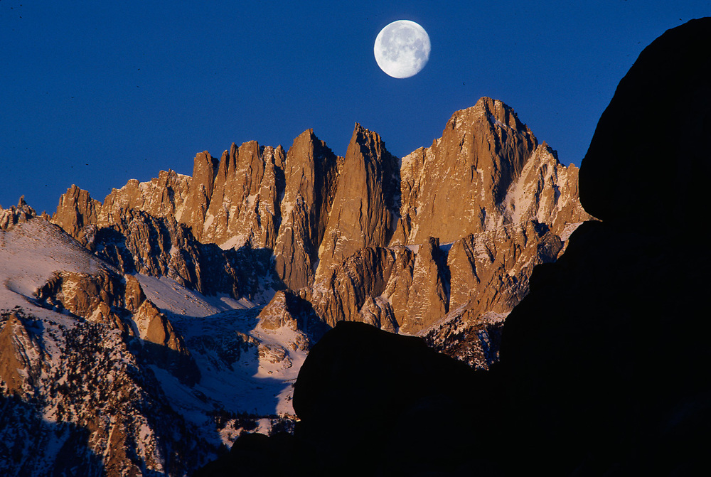 Moonset Over Mount Whitney viewed from Alabama Hills, morning light, Eastern Sierra Mountains, Sequoia National Park, California, USA