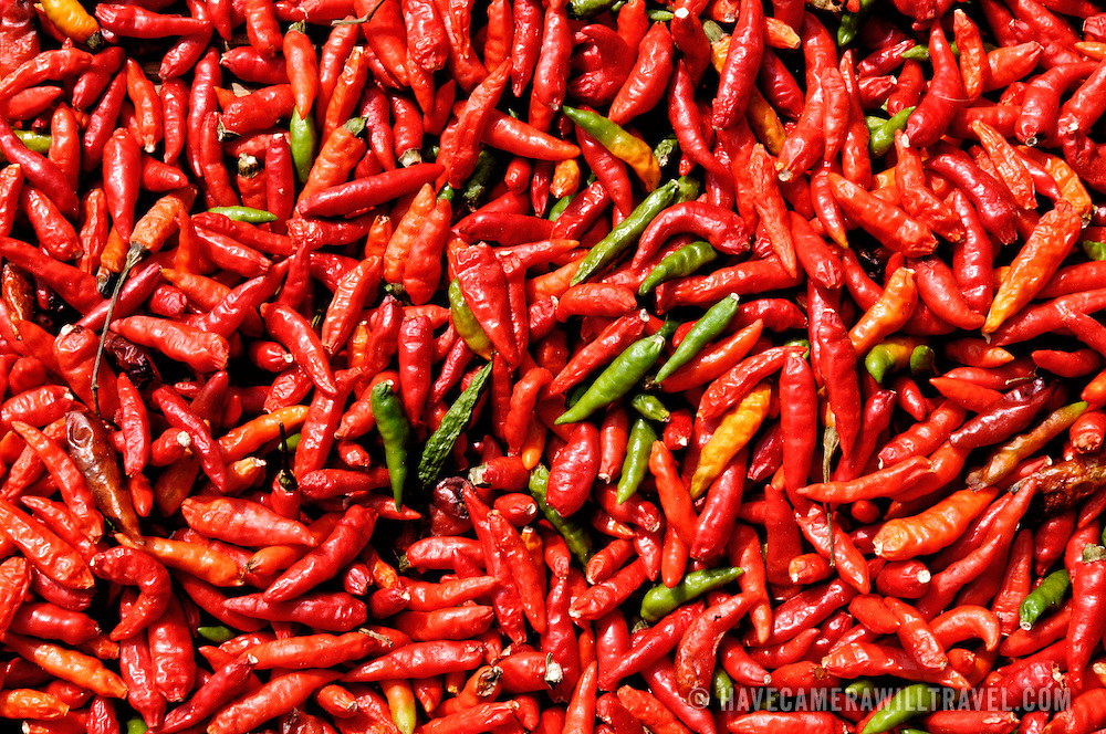 """Known to some as """"Lao shrimp"""", red chilis are left out in the sun to dry. Luang Namtha province, Laos."""