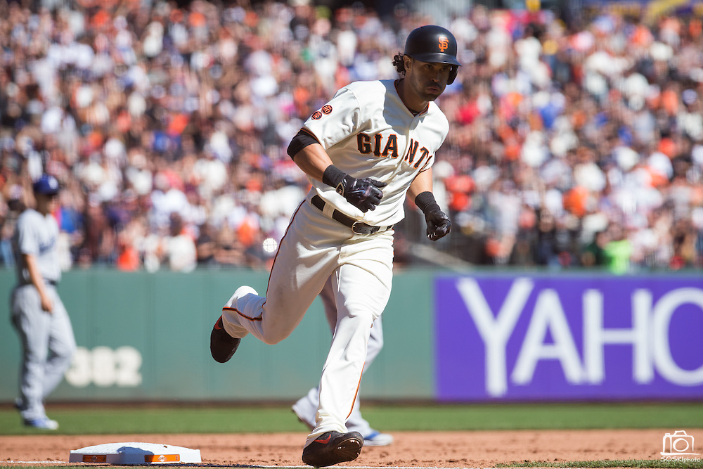 San Francisco Giants left fielder Angel Pagan (16) runs the bases after hitting a home run against the Los Angeles Dodgers at AT&T Park in San Francisco, Calif., on October 1, 2016. (Stan Olszewski/Special to S.F. Examiner)