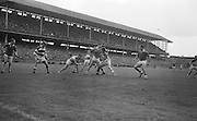 GAA All Ireland Minor Football final Cork V. Offaly 27th September 1964 at Croke Park..M. Byrne of Offaly in possession with S. Crawley and P. Lyne of the Cork Back line ..27.9.1964  27th September 1964