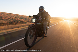 Doug Jones on his 1914 Indian Model F races out at sunrise on the Motorcycle Cannonball coast to coast vintage run. Stage 9 (294 miles) from Pierre to Sturgis, SD. Sunday September 16, 2018. Photography ©2018 Michael Lichter.
