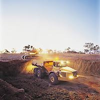 Shift change - Excavator and truck working into the night<br /> Kimberley Diamond Mine<br /> Ellendale