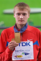Valeriy Borchin of Russia receives the gold medal during the medal ceremony for the men's 20 Kilometres Race Walk Final during day one of the 2009 IAAF Athletics World Championships on August 15, 2009 in Berlin, Germany. (Photo by Vid Ponikvar / Sportida)