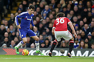 Oscar of Chelsea looks to go past Matteo Darmian of Manchester United . Barclays Premier league match, Chelsea v Manchester Utd at Stamford Bridge in London on Sunday 7th February 2016.<br /> pic by John Patrick Fletcher, Andrew Orchard sports photography.
