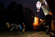 People react during an Israeli air strike in Gaza City.