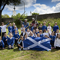 """Pupils of St Ninians PS in Stirlingenjoy the event with two gentlemen from Clanranald Trust dressed as Wiliam Wallace and Andrew de Moray.<br /> <br /> BRAVEHEART HEROES, WILLIAM WALLACE AND ANDREW DE MORAY, FINALLY HONOURED AT STIRLING BRIDGE BATTLE SITE AS SALTIRE RAISED FOR FIRST TIME IN OVER 700 YEARS<br /> <br /> Friday 29th May, 2015<br /> <br /> IT'S TAKEN more than 700 years but today, the two heroes at the centre of one of the most important battles in Scottish history have been jointly honoured at the spot where they both led an outnumbered Scottish army to victory against the English.<br /> The formal unveiling ceremony at Stirling Bridge today (Friday 29th May), of three lecterns made of traditional Scottish whinstone dedicated to the memory of William Wallace and Andrew de Moray,at site of the historic victory at Battle of Stirling Bridge.<br /> At a special ceremony attended by Andrew de Moray's direct descendant, the Earl of Moray, and Stewart Maxwell, MSP, convener of the Scottish Parliament's Education and Culture Committee, the memorials were formally unveiled.Mr Maxwell opened the event and after the dedication, together with the Earl of Moray, they raised the Saltire together at the site of the Battle of Stirling Bridge. This is the first time in over 700 years that the Saltire has flown at Stirling Bridge. The flag will now become a permanent fixture at the site of the Battle.<br /> John Stuart, the current Earl of Moray, said of his illustrious kinsman: """"I am delighted that Andrew de Moray is finally, after 700 years, to have the recognition he deserves. The Guardians of Scotland have put a huge amount of time and effort into the lecterns, which are a very fitting tribute to one of Scotland's greatest patriots.""""<br /> The victory represented a key moment in the Scottish Wars of Independence. Eminent Scots historian, Sir Tom Devine, recently described the battle as being 'second in importance only to Bannockburn in the Wars of Independence'.<br """