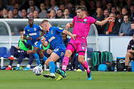 AFC Wimbledon midfielder Max Sanders (23) battles for possession with Rochadale midfielder Aaron Morley (28) during the EFL Sky Bet League 1 match between AFC Wimbledon and Rochdale at the Cherry Red Records Stadium, Kingston, England on 5 October 2019.