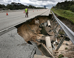 A Florida Highway Patrol trooper inspects a closed segment of Interstate 4, near State Road 434, in Longwood, FL, USA on Monday, September 11, 2017, after a portion of the interstate highway northeast of Orlando washed away during Hurricane Irma's passing through central Florida on Sunday night. Photo by Joe Burbank/Orlando Sentinel/TNS/ABACAPRESS.COM
