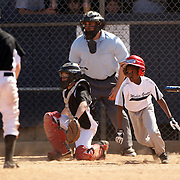 A young baseball player runs on a hit while batting during the Norwalk Little League baseball competition at Broad River Fields,  Norwalk, Connecticut. USA. Photo Tim Clayton