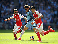 Arsenal's Aaron Ramsey tussles with Manchester City's Leroy Sane during the FA Cup Semi Final match at Wembley Stadium, London. Picture date: April 23rd, 2017. Pic credit should read: David Klein/Sportimage