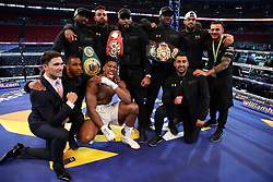 Anthony Joshua post fight with his training team following the IBF, WBA and IBO Heavyweight World Title bout against Wladimir Klitschko at Wembley Stadium, London.