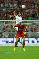 05.08.2015, Allianz Arena, Muenchen, GER, AUDI CUP, FC Bayern Muenchen vs Real Madrid, im Bild Nacho Fernandez (Real Madrid) ueberspringt Thomas Mueller (FC Bayern Muenchen) // during the 2015 Audi Cup Match between FC Bayern Munich and Real Madrid at the Allianz Arena in Muenchen, Germany on 2015/08/05. EXPA Pictures © 2015, PhotoCredit: EXPA/ Eibner-Pressefoto/ Stuetzle<br /> <br /> *****ATTENTION - OUT of GER*****