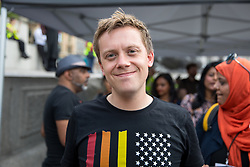 © Licensed to London News Pictures. 13/07/2018. London, UK. Journalist and political commentator Owen Jones joins tens of thousands of demonstrators marching through central London to protest against the President of the United States, Donald Trump, and his ongoing four-day visit to the UK. The demonstration began at Portland Place and ended with a rally at Trafalgar Sqaure. Photo credit : Tom Nicholson/LNP