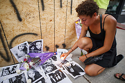 Friend of 18-year-old Danforth shooting victim Reese Fallon, Desirae Shapiro 19, leaves a candle on pictures of her friend Reese at a makeshift memorial remembering the victims of a shooting on Sunday evening on Danforth, Ave. in Toronto, ON, Canada, on Monday, July 23, 2018. Photo by Mark Blinch/CP/ABACAPRESS.COM