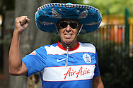 a QPR fan wearing a sombrero & Ray Bans while posing outside Loftus Road before k/o. Skybet EFL championship match, Queens Park Rangers v Leeds United at Loftus Road Stadium in London on Sunday 7th August 2016.<br /> pic by John Patrick Fletcher, Andrew Orchard sports photography.