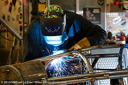 Keith Ball working on his Bonneville Salt Torpedo belly tank trike in the Bikernet World HQ shop in Wilmington, CA, USA. Monday, June 24, 2019. Photography ©2019 Michael Lichter.