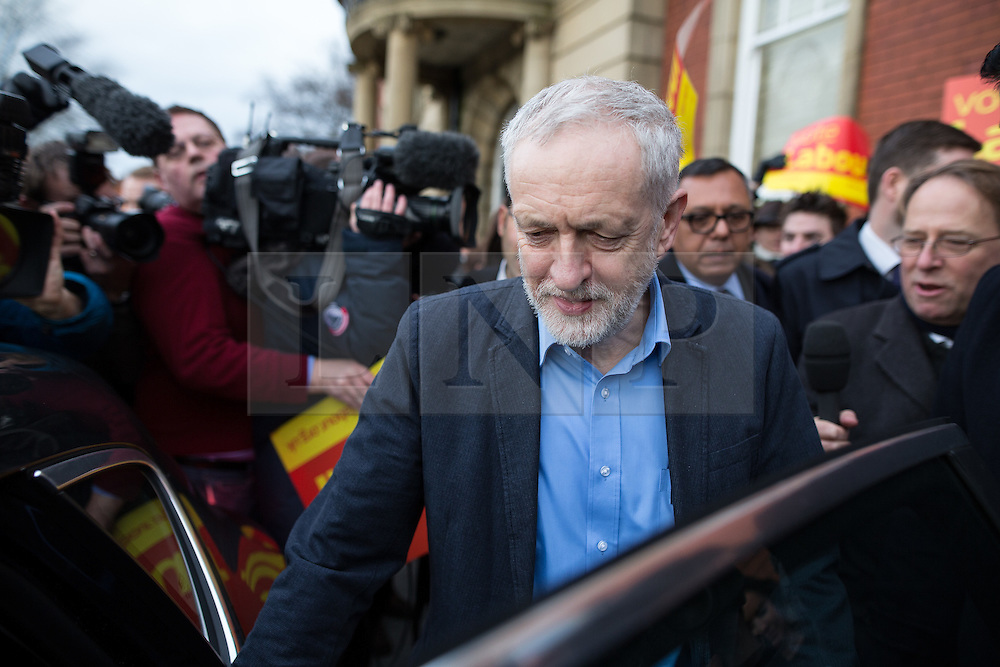 © Licensed to London News Pictures . 04/12/2015 . Oldham , UK . JEREMY CORBYN leaves after joining winning candidate Jim McMahon on the steps of Chadderton Town Hall in Oldham for a victory rally following Labour's success in the Oldham West and Royton by-election . Photo credit : Joel Goodman/LNP